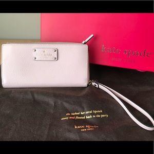 Kate Spade Blush Pink wallet with wrist strap